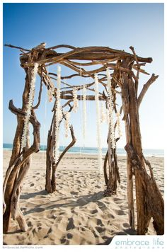 Definitely want to get married under a standing structure (maybe with flowers, rhinestones or shells hanging down.)