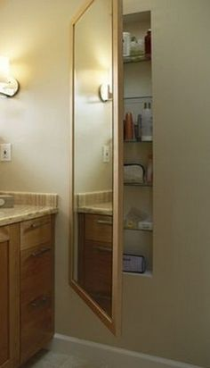 Master Bath - Use space between studs with a hinged mirror in front for extra storage (cleaning supplies, excess bath/hair products, medicine cabinet, etc) by Gingerslam