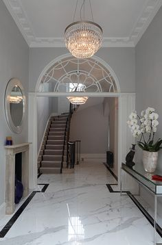 Complete restoration and modernisation of Georgian Townhouse in Marylebone. Living Room Tiles, Marble Flooring Design, Townhouse Interior, House Flooring, White Marble Floor, Interior Staircase, Entrance Hall Decor, Luxury Interior, Tiled Hallway