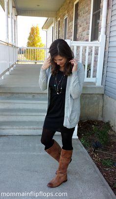 black dress + Cardigan  brown riding boots