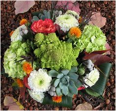 Fall table arrangement by Vibrant Flowers in Portland, Oregon. The romanesco add beautiful texture!