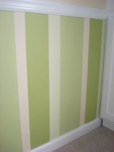 Different shades of green on wall
