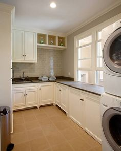 Looks like a show home laundry room! No one's can actually look like this...but I like