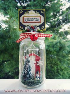 Winter Home in a Mason Jar - Scrapbook.com - Use a mason jar and Cosmo Crickey Show Toppers, Mini Mobiles and Wood Charms to create this darling scene in a jar gift!