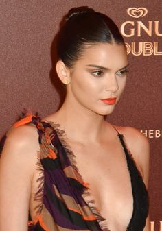 Kendall Jenner's slicked-back bun and red lip were a perfectly glamorous combo at a Magnum Beach party.