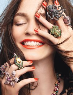♔  All Things Rings.  She's so pretty, love the orange nails & lipstick... but what's with all the octopus I'm seeing??