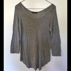 Brandy Melville 3/4 sleeve Top Baseball style top by Brandy Melville. 3/4 sleeve. Soft and stretchy fabric. 57% cotton/40% viscose/3% elastane. Worn only a handful of times. In good condition. No trades please. Brandy Melville Tops Tees - Long Sleeve