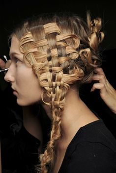 Alexander McQueen's woven hair. Only if you have a couple of hours to spare ;)