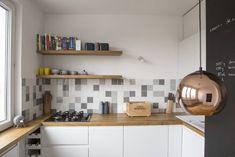 Zdjęcie numer 12 w galerii - 14 sposobów na nowoczesną ścianę nad kuchennym blatem