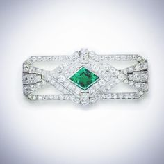 Green with Envy : A Beautiful Art Deco Emerald and Diamond brooch #thegemdialogue #jewelry #jewelleryblog #emerald #artdeco #oldcutdiamonds #brooch #love #likeforlike #gotgreen #desire #jewellery #jewelrygram