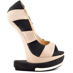 Go against the Grain in this unique pump by Shoe Republic.  A black and white large striped upper is created from a synthetic leather.  A sculpted 7 inch heel features a thick black base and partially hidden 2 inch platform.  Stand out the from the crowd in this hot style!