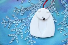 Cute little Polar Bear ornament perfect for your holiday decorating. The glass layers that make up this ornament have been cut by me, layered and kiln fired just long enough to fuse the pieces together without losing their dimension. Polar Bear is 2.5x3 and hangs from a red