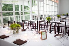 Modern loft table centerpieces in green and brown with framed table numbers.