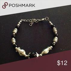 SALE Silver tone and black bracelet Nice silver tone and black costume jewelry bracelet with cute fish spacers. Jewelry Bracelets