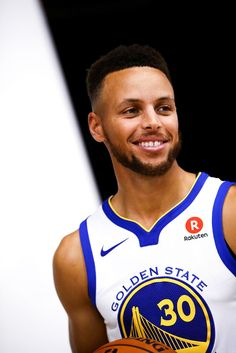 343d56b7738 Stephen Curry of the Golden State Warriors poses for a portrait during a  photo shoot during the Golden States Warriors media day at Rakuten.