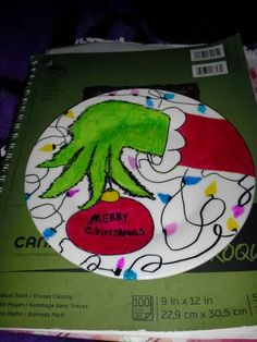 Grinch pin on plate. Sharpie.
