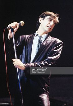 Bryan Ferry from Roxy Music performs on stage wearing a leather suit on his 'In Your Mind' solo tour in March 1977 in Amsterdam, Netherlands.