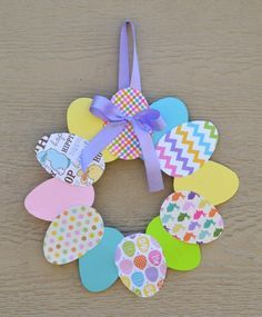 This is a easy paper Easter wreath craft that kids and adults can enjoy.: This is a easy paper Easter wreath craft that kids and adults can enjoy. Wreath Crafts, Jar Crafts, Cute Crafts, Diy And Crafts, Diy Wreath, Wreath Ideas, Flower Crafts, Handmade Crafts, Easy Easter Crafts