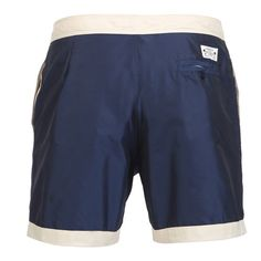 BOARDSHORTS COLOR BLUE/BEIGE Navy blue memory polyester mid-length Boardshorts with contrast waistband and bottom. Fixed waistband with Velcro closure and adjustable drawstring. Two front pockets and welt back buttoned pocket. Cuisse de Grenouille brand patch on back. Internal net. COMPOSITION: 100% POLYESTER. Model wears size L, he is 189 cm tall and weighs 86 Kg.