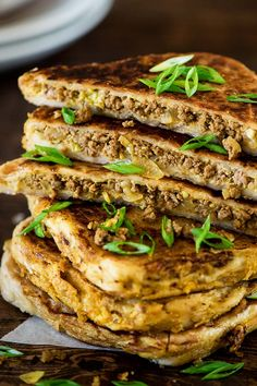 Spiced Beef Roti Turnover (Murtabak). A popular street food by the Indian Muslims in Malaysia. #Malaysin [frozen roti pratha + filling: ground beef, cabbage, turmeric, onion, nutmeg + eggs]