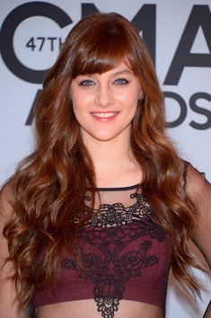 Aubrey Peeples long hair with bangs wavy hairstyle