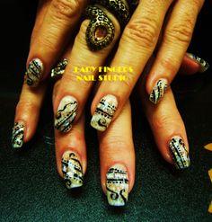 #nails #nailart #gelnails #nailporn #nailideas #trendynails #tribal #handpainted #gelpolish #art #Egyptian #glitter #bling #white #sexy