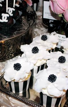 Lovely cupcakes at a Coco Chanel birthday party!  See more party planning ideas at CatchMyParty.com!