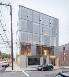 This building in Portland, Oregon has an engineered timber frame that is visible behind a glass curtain wall.