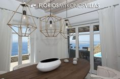 The modern open style kitchen of the residence, is fully functional with top of the range amenities and connects directly onto the formal dining area and living room. FMV1501 Villa for Rent on Mykonos island Greece. http://florios-mykonos-villas.com/property/fmv1501/