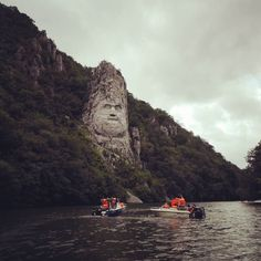 """A mighty statue over a mighty river! Even if it's raining or cloudy you still have to visit King Decebal's statue at the """"Cazanele Dunarii"""" section of the Danube. It's the biggest statue in Europe! Take a Danube cruise for the full experience!   #Romania #Europe #Danube #cruise #boat #art #culture #river #statue #amazing #nice #great #beautiful #nature #awesome #travel #instatravel #traveler #travelgram #ILoveToTravel #record #clouds #rainyday"""
