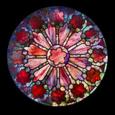 A TIFFANY STUDIOS LEADED FAVRILE GLASS WINDOW 1892-1928.