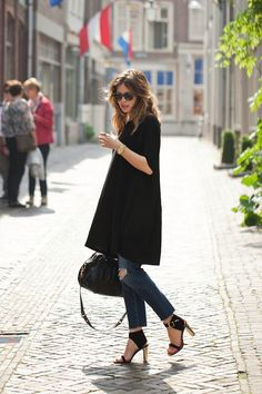 Loving a long black aline tunic with worn in skinny jeans and a frayed hem ... street style chic.
