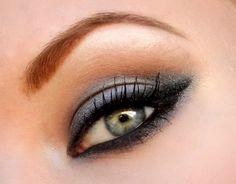 Grey smokey eye from Urban Decay's Naked Palette. Lovely brow too.