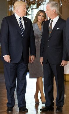 US President Donald Trump (L), King Philippe of Belgium (R) and First Lady of the US Melania Trump (C) pose prior to a reception at the Royal Palace in Brussels, on May 24, 2017.