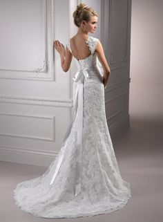 Lorie Bridal Gown by Maggie Sottero: love the cap sleeve but dislike the signature corset in the back.