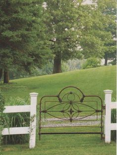 iron bed used as a garden gate