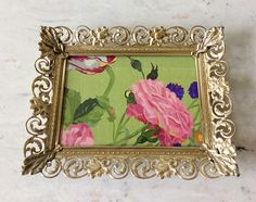 Gorgeous 5 x 7 gold metal filigree picture frame. Whitewashed over gold with a floral scroll design & decorative ornate corner details! Back easel for standing horizontal or vertical & hook for hanging. In very good vintage condition not frame & original glass. Will ship insured!  Measures 8.75 x 7 total, fits a 5 x 7 picture Several vintage frames sold in shop!  Thanks for shopping YellowHouseDecor!  Please visit my sisters shop for more vintage items Ellansrelics02