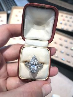 The sparkle is mesmerizing on this Edwardian 1915 vintage engagement ring featuring a bright 1.09 carat marquise cut diamond dancing in the light.