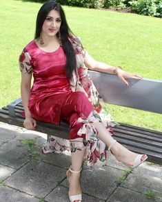Tie trousers and digital prints are trending. I made this outfit out of scarlet satin fabric and rose digital print silk chiffon. I used the silk chiffon as the trouser ties, cap sleeves and dupatta! Styled with statement earrings. Iranian Women Fashion, Indian Fashion, Frock Fashion, Fashion Dresses, Women's Fashion, Pakistani Dresses, Indian Dresses, Indian Designer Suits, Stylish Girls Photos