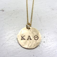 You can get these custom made for the Greek letters of your sorority: Sorority Jewelry Gold Disc Necklace by onelifejewelry, $48.50
