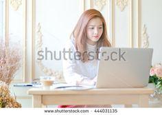Beautiful business woman using a laptop computer
