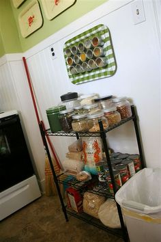 A good idea for baking supplies!  I like the metal TV table top mounted to the wall for use as a magnet board!