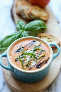 Caprese Tomato Soup - Served caprese-style with burrata, balsamic reduction, and fresh basil leaves!