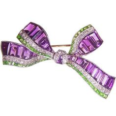 Purple, Green & White were the symbolic colours of the Suffragette movement; English Platinum & Gold Bow brooch, set with Amethyst baguettes, green Demantoid Garnets & Diamonds. Bow Jewelry, Purple Jewelry, Amethyst Jewelry, High Jewelry, Jewelry Design, Silver Jewelry, Gold Jewellery, 925 Silver, Suffragette Jewellery