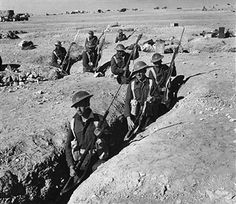 British infantry soldiers armed with bayonets standing in the trenches abandoned by the Italian troops at Sidi Omar.áSidi Omar, 6th June 1941 - pin by Paolo Marzioli