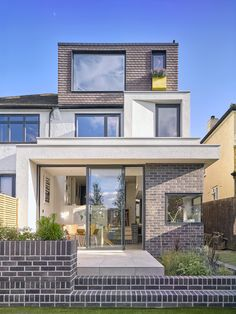 This two-storey rear extension creates an open, social space, which includes kitchen, dining, study and relaxing areas at ground level. Our expert guide tells you how 1930s House Extension, House Extension Design, Roof Extension, House Design, Extension Ideas, Extension Costs, Extension Google, Modern Style Homes, House Extensions