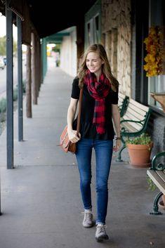 red plaid scarf + nice black tee + jeans + crossbody saddle bag