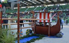 2 / 16 The Viking boat at fence 3 has its own oars and anchor Credits: Storm Johnson  Read more at http://www.horseandhound.co.uk/weg/weg-showjumping/weg-sj-gallery/#bpUdlTHchyQ6BMPQ.99 WEG showjumping: fence designs celebrate the best of Normandy [PICS] - Horse & Hound