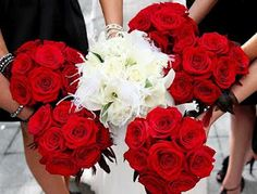Bridesmaids red roses, Bride white (calla) lilies -- love the idea, but the bride's flowers are too...white?