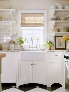 I'd be a stay at home dog mom if I had this kitchen.  I would have to be to keep the open shelving clean!